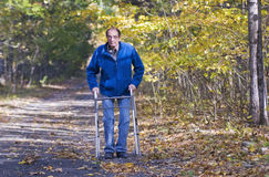 Man with walker3 Royalty Free Stock Photos