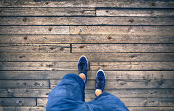 A man walking on aged wooden floor stock images