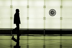 Man walking through an airport Royalty Free Stock Image