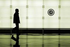 Man walking through an airport royalty free stock image