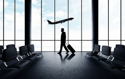 Man walking in airport Royalty Free Stock Photos