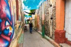Man Walking through an Alley Royalty Free Stock Photos