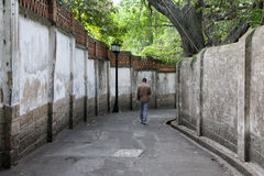 Man walking in an alley on Gulangyu Island in China Stock Images