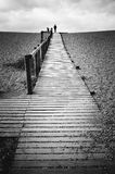 Man walking alone on jetty Stock Images