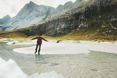 Man walking alone in mountains travel lifestyle Stock Photo
