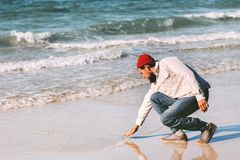 Man walking alone on sea beach summer travel vacations royalty free stock photos