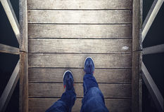 Man walking alone on wooden floor Royalty Free Stock Photography