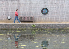 Man Walking Along Canal Royalty Free Stock Images