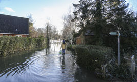 Man Walking along Flooded Thames footpath stock photos