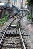 Train street, Hanoi, Vietnam. Man walking along railway tracks in Train Street, Hanoi, Vietnam Stock Photos