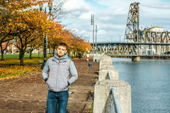 Man walking along the riverwalk in Portland city at autumn Royalty Free Stock Photography