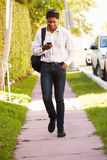 Man Walking Along Street To Work Listening To Music Royalty Free Stock Photography