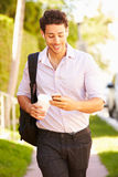 Man Walking Along Street To Work Listening To Music Royalty Free Stock Images