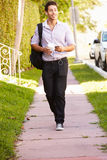 Man Walking Along Street To Work Listening To Music Stock Photo