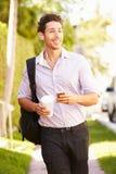 Man Walking Along Street To Work Listening To Music Stock Image