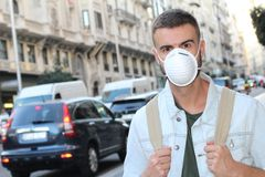 Man walking around a polluted city royalty free stock photography