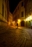 Man walking around the  street of the old town at night in Pragu Royalty Free Stock Photo
