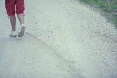 Man Walking Away. Man on a Road Royalty Free Stock Image