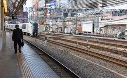 A man walking away at the train platform. Shinjuku, Tokio, Japan - April 8th, 2017: A man is walking away of the train platform at the Shinjuku Train Station Royalty Free Stock Photography