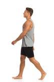 Man Walking Barefoot. Side View Royalty Free Stock Image
