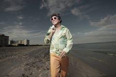 Man walking on the beach Royalty Free Stock Photos
