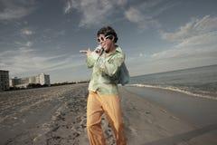 Man walking on the beach Royalty Free Stock Photo