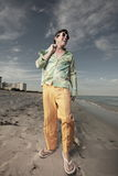 Man walking on the beach Stock Photography