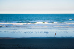Man walking on the beach Stock Photo