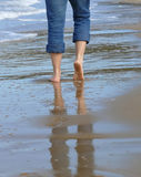 Man walking on the beach Stock Images