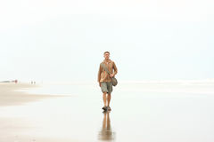 Man walking on beach Stock Image