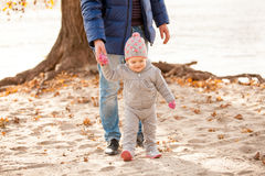 Man walking on beach with little girl Royalty Free Stock Image