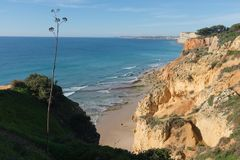 Man on a beach during low tide in Lagos, Algarve, Portugal stock image