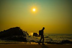 Man walking on beach morning sunrise time stock photography