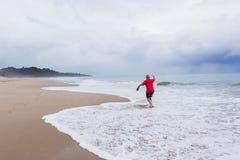 Man Walking Beach Ocean Stock Photo