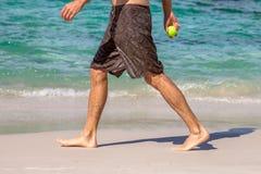 Man walking on beach Stock Photo