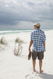 Man walking on beautiful pristine beach Stock Photo
