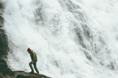 Man walking at big waterfall outdoor Travel Lifestyle. Survival concept adventure scandinavian vacations in Norway wild nature stock image