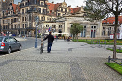 Man walking bike in Theaterplatz Stock Photography