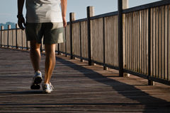 Man walking on boardwalk Royalty Free Stock Image