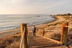 Man walking at boardwalk to beach, Malibu. Man walking at boardwalk to Leo Carrillo State Beach, Malibu, California Royalty Free Stock Photography