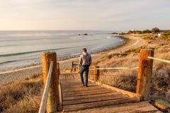Man walking at boardwalk to beach, Malibu. Royalty Free Stock Photography