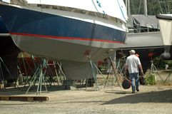 Man walking in boatyard Stock Photos