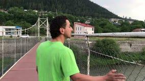 Man walking by bridge in borjomi georigia travel concept stock footage