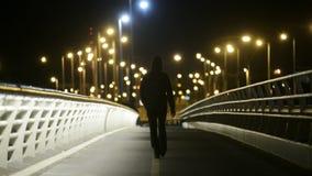 Man Walking on Bridge stock video footage