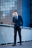 Man walking on the bridge. Young handsome businessman walking on the bridge Royalty Free Stock Photography