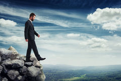 Man walking on the brink of a precipice royalty free stock photography
