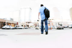 Man walking in city Stock Photo
