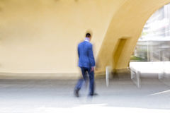Man walking in the city, motion blur Stock Photography