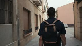 Man walking in city, tourist traveling. stock video