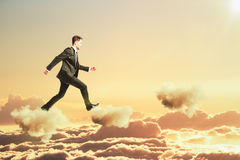 Man is walking on clouds in the sky concept Royalty Free Stock Image